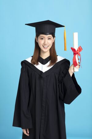Happy asian female graduate student holding diploma