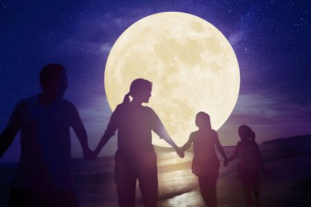 family walking on beach and watching the moon.Celebrate Mid autumn festival concept Banque d'images