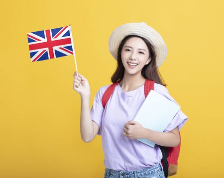 Young asian girl student showing the United Kingdom flag