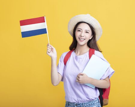 Young asian girl student showing the Netherlands flag