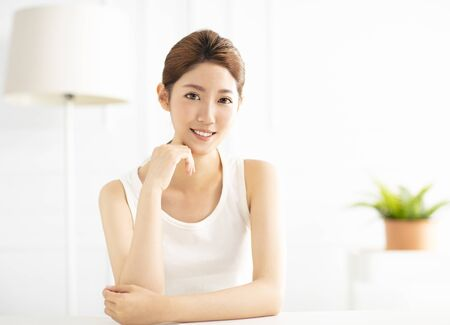 smiling young asian woman in living room