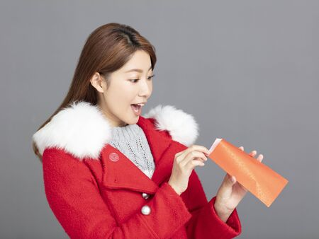 Young asian Woman in winter clothes celebrating chinese new year