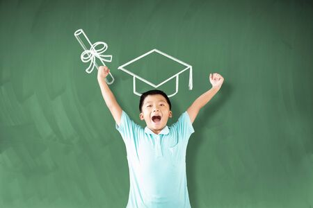happy little boy student with graduation concepts