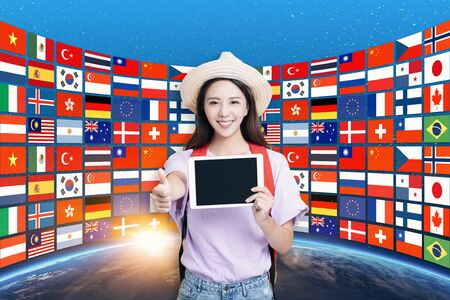 student girl showing tablet computer and international study tour concept