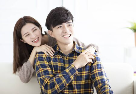 Cheerful young couple at home in the morning