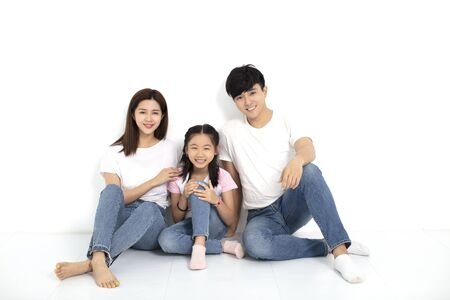 Happy asian Young family Sitting On Floor 写真素材