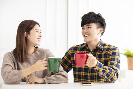 Happy young couple   drinking tea. Reklamní fotografie - 129625119