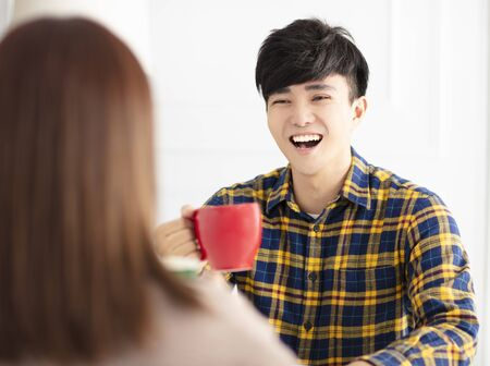 Happy young couple   drinking tea.