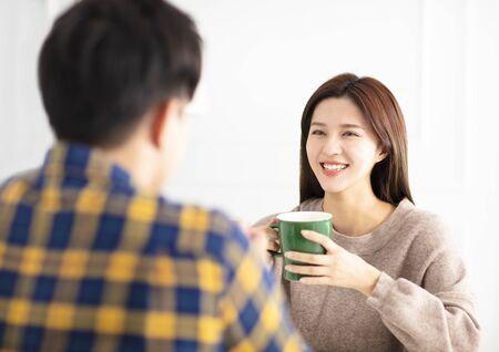 Happy young couple   drinking tea. Reklamní fotografie - 129625153