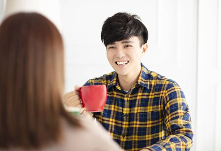 Happy young couple  drinking tea. Reklamní fotografie