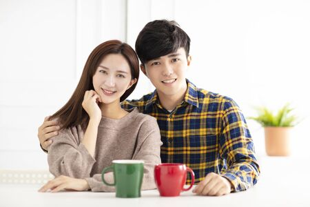 Happy young couple  smiling and drinking tea. Reklamní fotografie