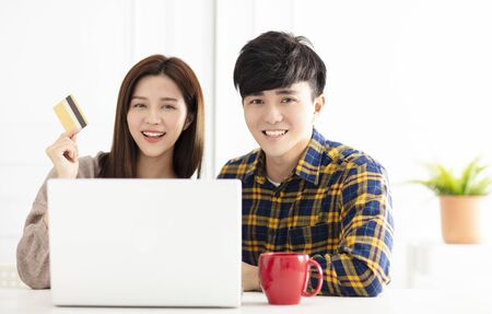 Happy young couple  shopping online by laptop 写真素材