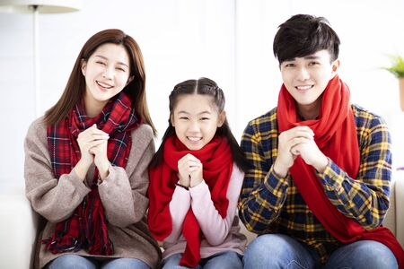 happy asian family with congratulation gesture for chinese new year Reklamní fotografie - 129625718