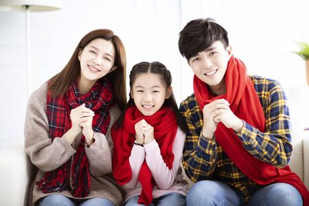happy asian family with congratulation gesture for chinese new year Stock Photo