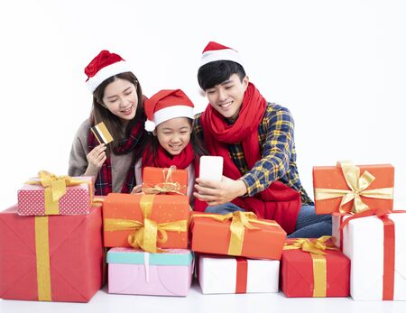 happy family shopping christmas gift by smartphone