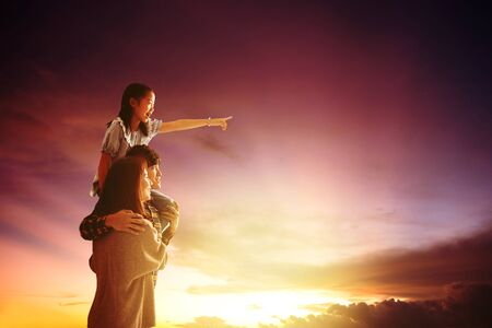 asian family standing and watching the sunset Stok Fotoğraf