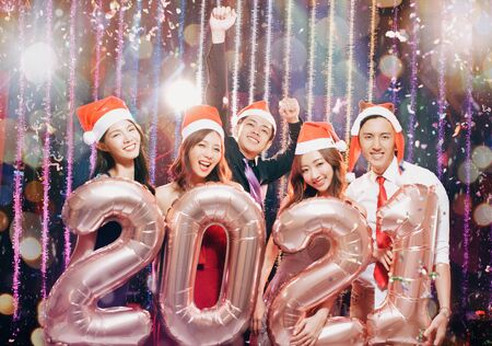 young group celebrating new yew 2021 in christmas party 版權商用圖片