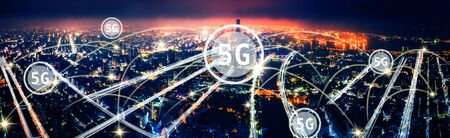 aerial view city at  night  and 5g network  tech concepts Stock Photo