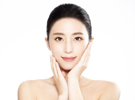 Beautiful face of young woman with clean fresh skin Imagens