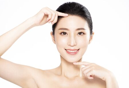 Closeup of Smiling beauty  Making finger Gesture