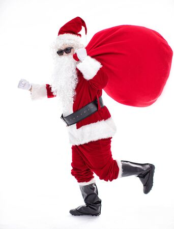 Santa Claus carrying sack full of gifts Archivio Fotografico - 133673297
