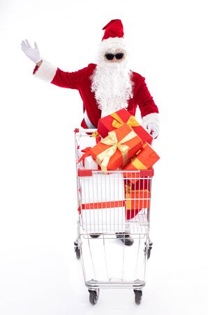 Happy Santa Claus with Christmas shopping cart Archivio Fotografico - 133673355