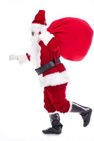 Santa Claus carrying sack full of gifts Archivio Fotografico - 133673357