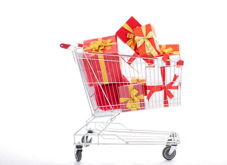 closeup shopping cart with gift box