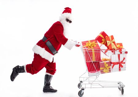 Happy Santa Claus with Christmas shopping cart Archivio Fotografico - 133673411