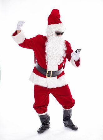 Happy  Santa Claus watching the smart phone Archivio Fotografico - 133673431