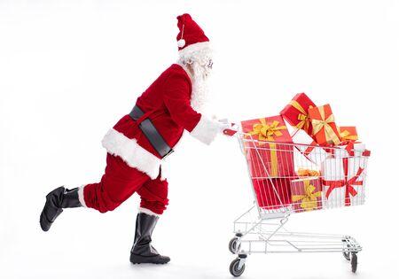 Happy Santa Claus with Christmas shopping cart Archivio Fotografico - 133673453