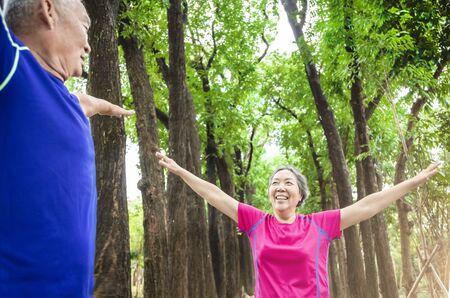 happy asian Senior  couple exercising outdoors
