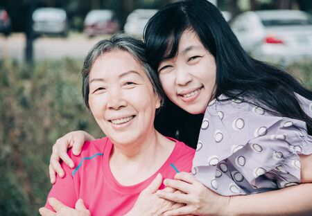 asian senior mother and her adult daughter are hugging Stock fotó