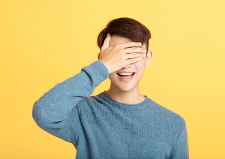 young man covering his eyes with hand Stock fotó