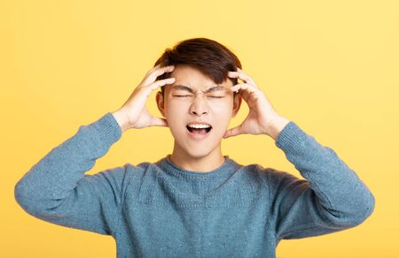 depressed man put his hands on his head
