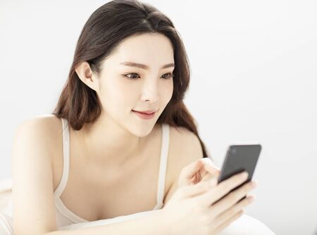Portrait of young  asian beauty using the smart phone