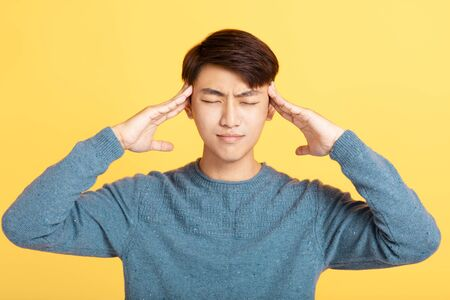 asian young man with headache