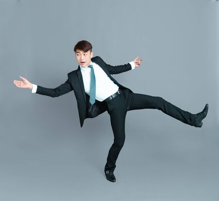 Happy young business man dancing in motion