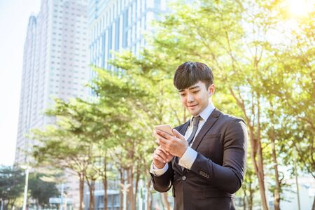 asian young businessman using mobile phone
