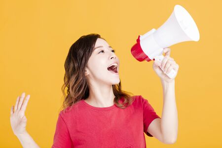 excited young woman with megaphone