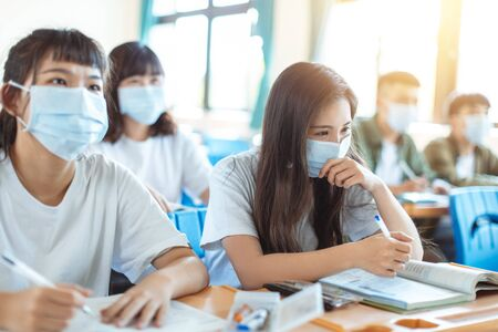 Students wearing protection mask to prevent germ, virus and PM 2.5 micron in classroom