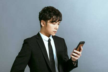 Handsome young businessman using mobile phone Zdjęcie Seryjne