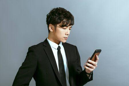 Handsome young businessman using mobile phone Foto de archivo