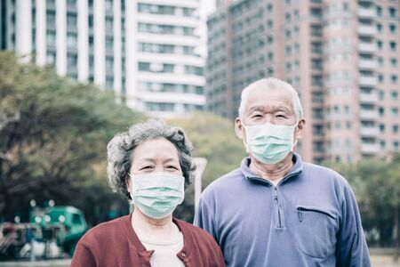 senior couple wear with protective face mask