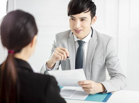 Manager Interviewing A Young businesswoman In Office Banco de Imagens