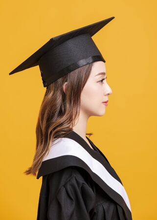 side view beautiful young woman in graduation gowns