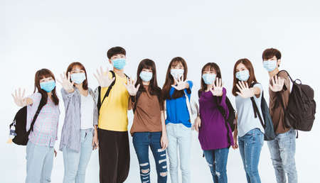 young student group wearing protective medical face masks standing together with stop gesture Stock fotó