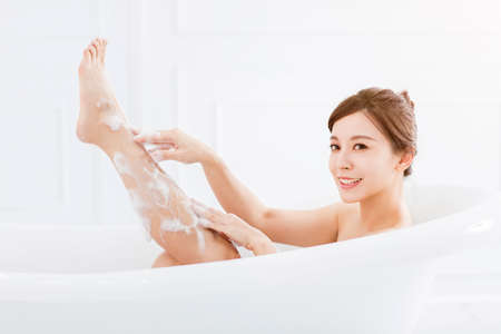 young woman take a bath in bathtub