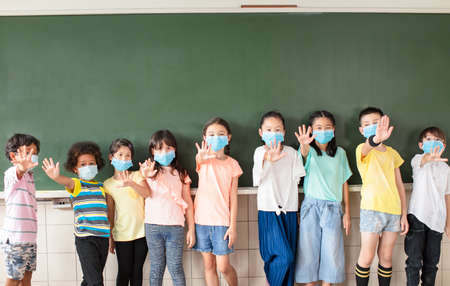 Group of children wearing face mask back at school after covid-19 quarantine
