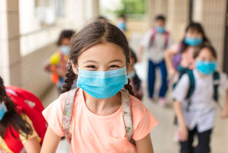 children wearing face medical mask back to school after covid-19 quarantine Stock fotó